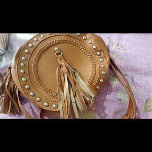 Tan tassel round sling bag